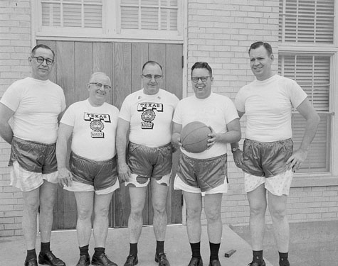 Five men in basketball shorts, 1960s, b&w photo by Bill Wood, copyright Billye Cooper and Connie Bruner, http://www.icp.org/site/c.dnJGKJNsFqG/b.3962307/