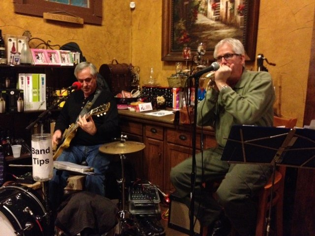 Paul Harrington sits in on harmonica with the Tu-Tones at Landon Winery in McKinney. On his left is Bob Wingate.