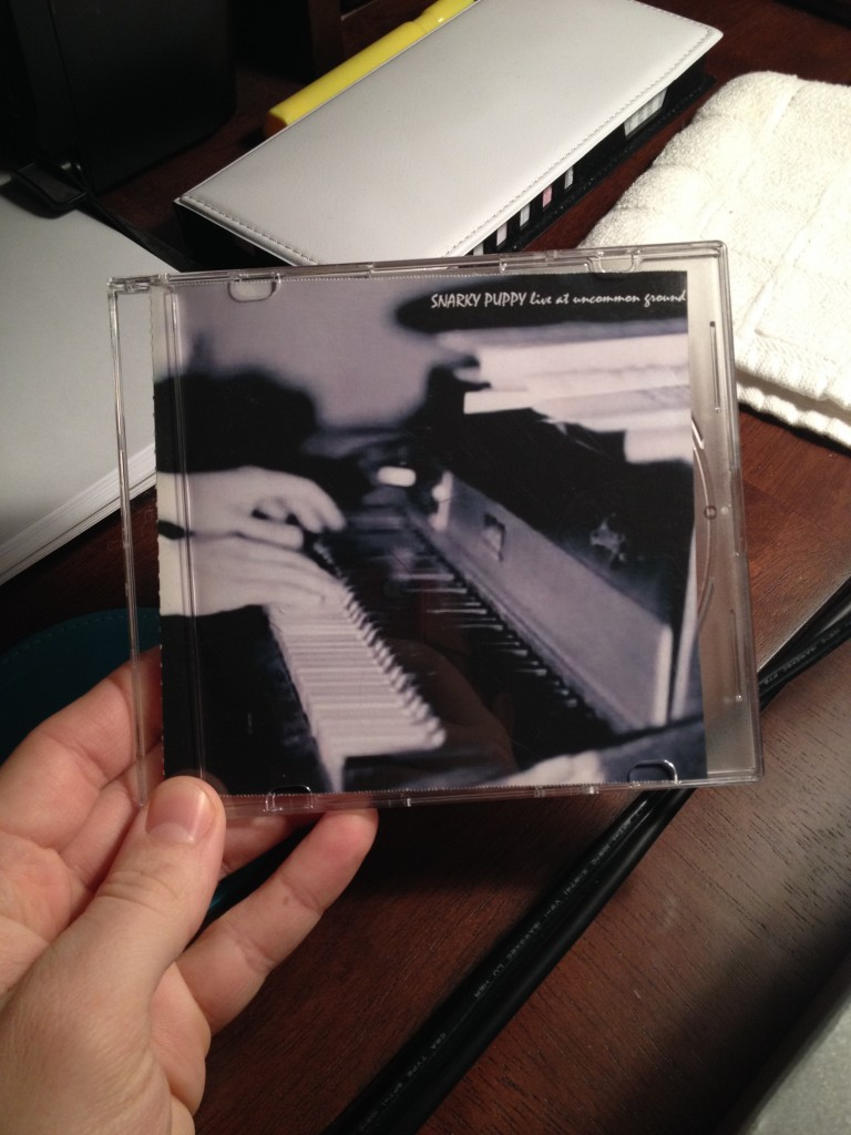 UNT Jazz Studies grad Ryan Jacobi holds Snarky Puppy's first record 'Live At Uncommon Ground' from 2005. It's tough to find these days.