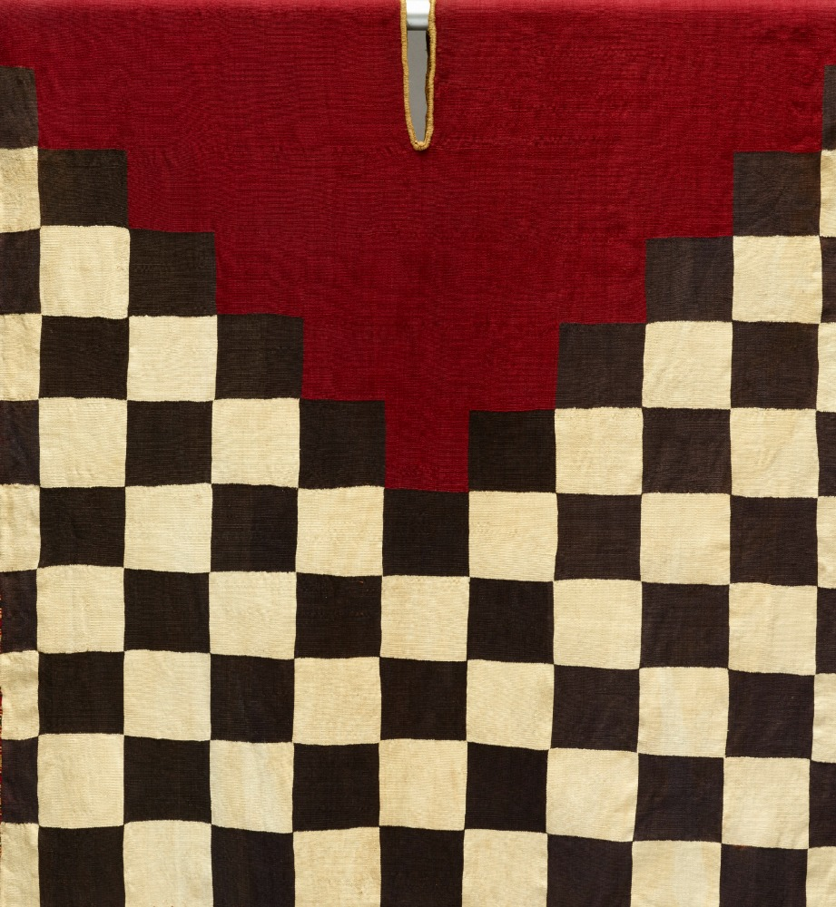 Tunic with checkerboard pattern and stepped yoke_1995.32.McD