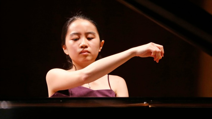 Evelyn Mo, 16, of the United States, performs in the quarterfinal round of the Cliburn International Junior Piano Competition and Festival, in Fort Worth, Texas, Wednesday, June 24, 2015. (Cliburn/Rodger Mallison)