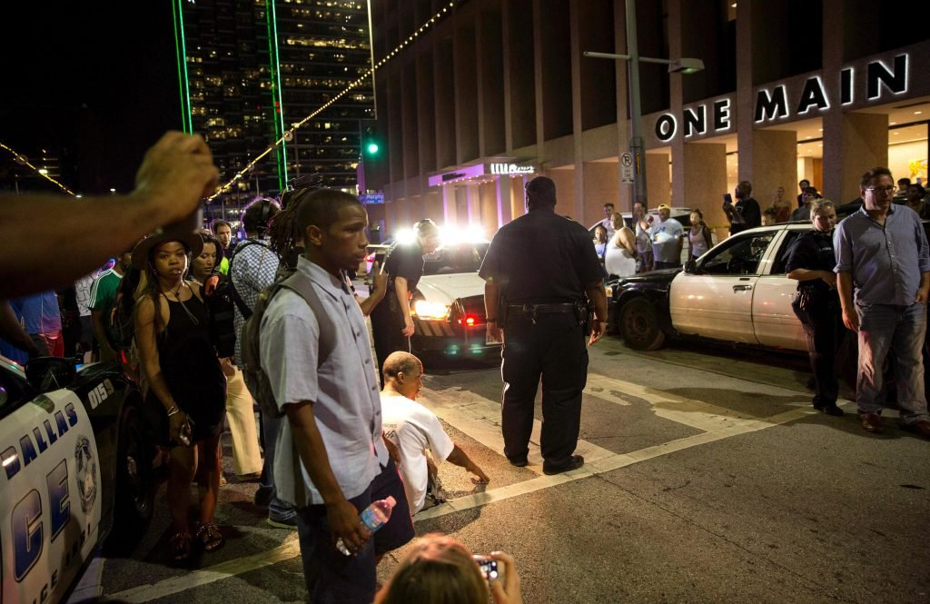 Police attempt to calm the crowd as someone is arrested near the scene ofthe sniper shooting in Dallas. Photo:LAURA BUCKMAN / AFP/GETTY IMAGES