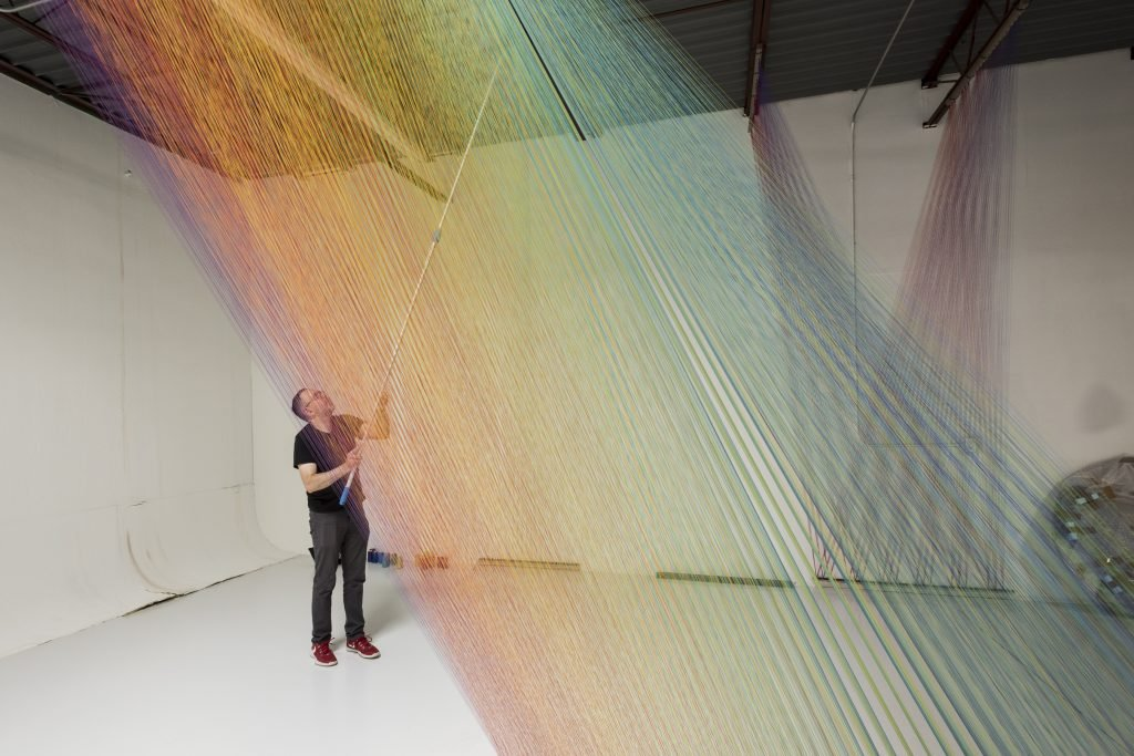 Artist Gabriel Dawe creating one of his threaded scultures. Photo: Amon Carter Museum of American Art