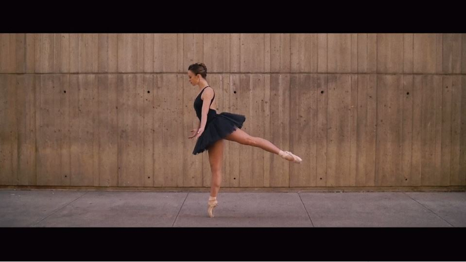 "A ballerina poses as part of ""City is a Poem."""