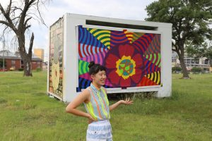Zou talks about the first of three murals created by artists at trans.lation. Photo: Hady Mawajdeh