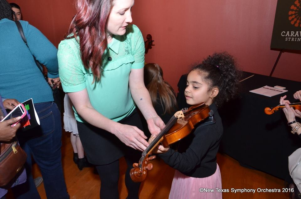 "Try on the violin for size at an instrument ""petting zoo."" Photo: New Texas Symphony Orchestra"
