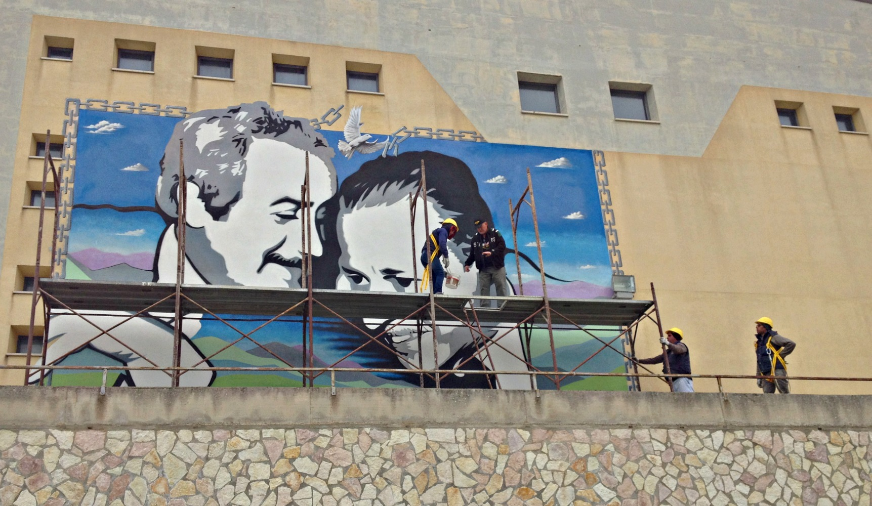 The scaffolding coming down on Frank Campagna's mural of Giovanni Falcone and Paulo Borsellino, the judges assassinated by the Mafia.