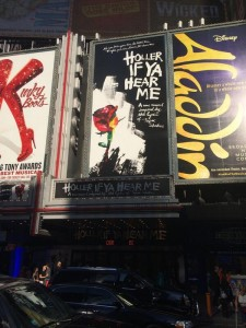 "Signs for ""Holler If You Hear Me"" in New York City. Photo: Jackson and cast in ""The Lion King."" Photo: twitter.com/ChrisisSingin"