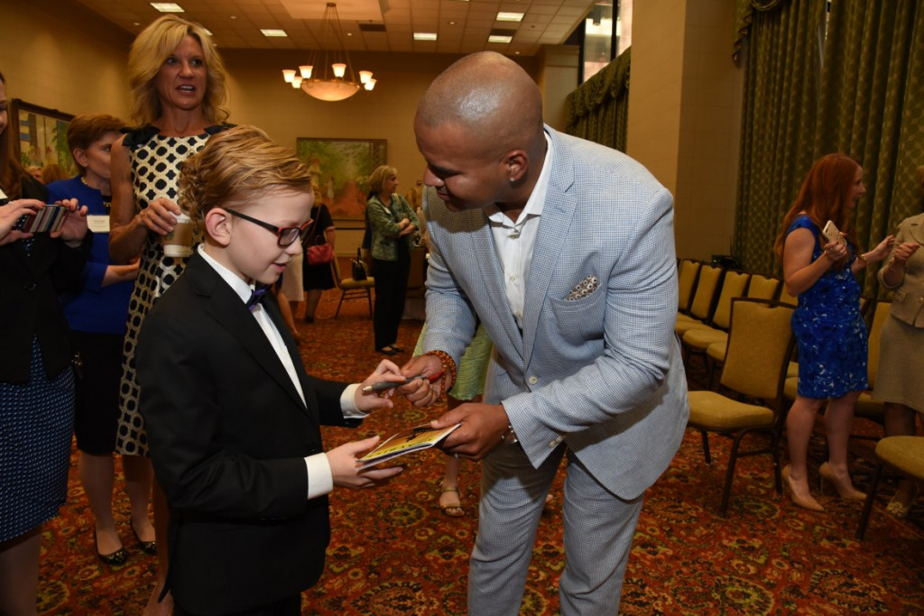 Christopher Jackson giving a young fan his autograph. Photo: Junior Players