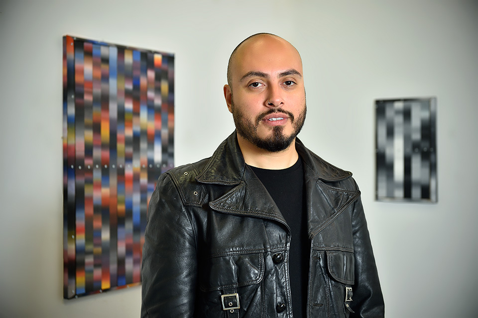 Artist Arthur Pena photographed in his west Dallas studio for North Texan in Dallas, Texas on May 14, 2015. Photos by Michael Clements.