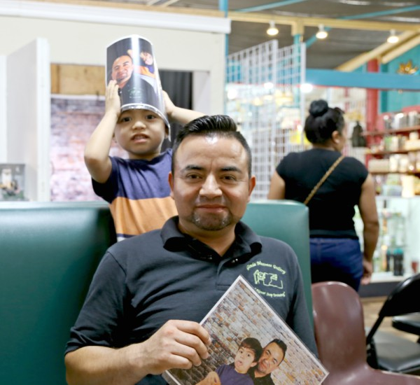 Jose Pineda and his son say they're happy about the photos Reyes has taken of them. Photo: Hady Mawajdeh