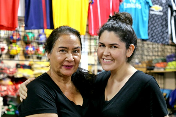 Alma Guzman (right) and her mother pose near Reyes' studio in Latina Plaza. Photo: Hady Mawajdeh
