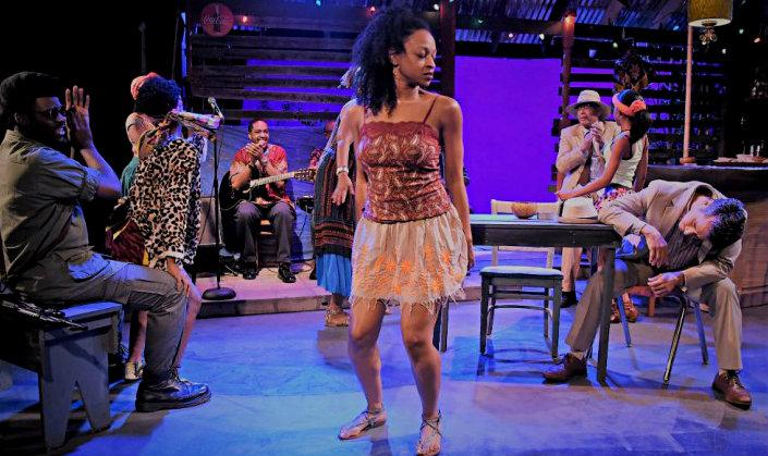 Kyndal Robertson (center) dancing for Mr. Harari (Isaiah Cazares). Photo: Linda Blase