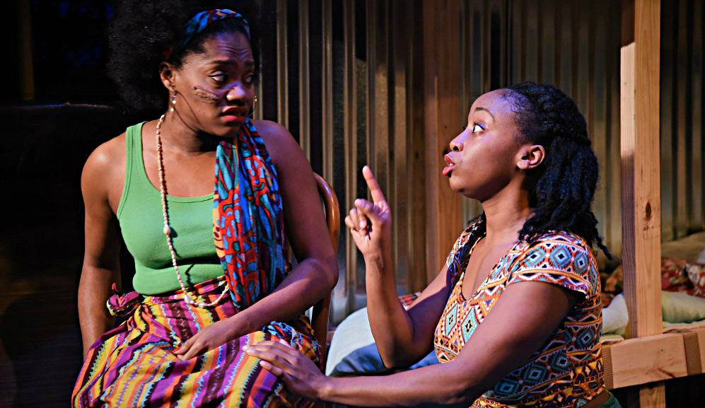 Salima (Kristen Bond) and Sophie (Whitney LaTrice Coulter) work in Mama's brothel in 'Ruined.' All photos: Rebecca Brooks
