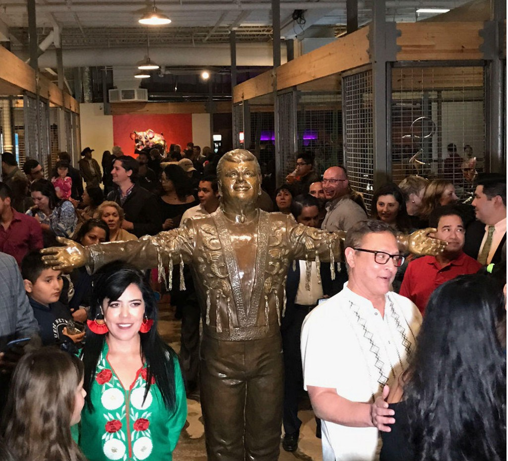 Mercado Artesanal opened in Oak Cliff over the weekend. Visitors are greeted at the entrance with a statue of the late Mexican singer Juan Gabriel. The sculpture is the work of artist Edysa Ponzanelly (left). Photos: STELLA M CHÁVEZ