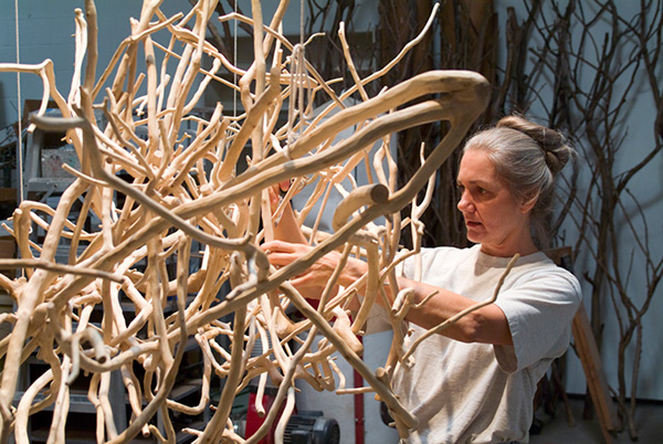 Artist Sherry Owens installing work for a show in the West Texas Triangle. Photo: Courtesy Sherry Owens