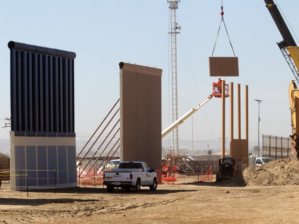 Crews work at the construction site of prototypes for President Trump's border wall in San Diego County. Photo: Bill Wechter for NPR