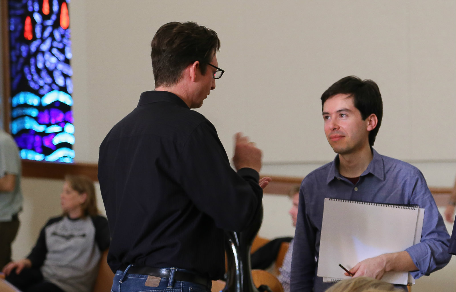 Consulting with TCU professor and composer Till McIvor Meyn (left). Photo: Jerome Weeks