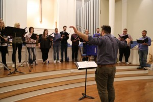 The ensemble rehearsing and being led by Brukhman. Photo: Hady Mawajdeh