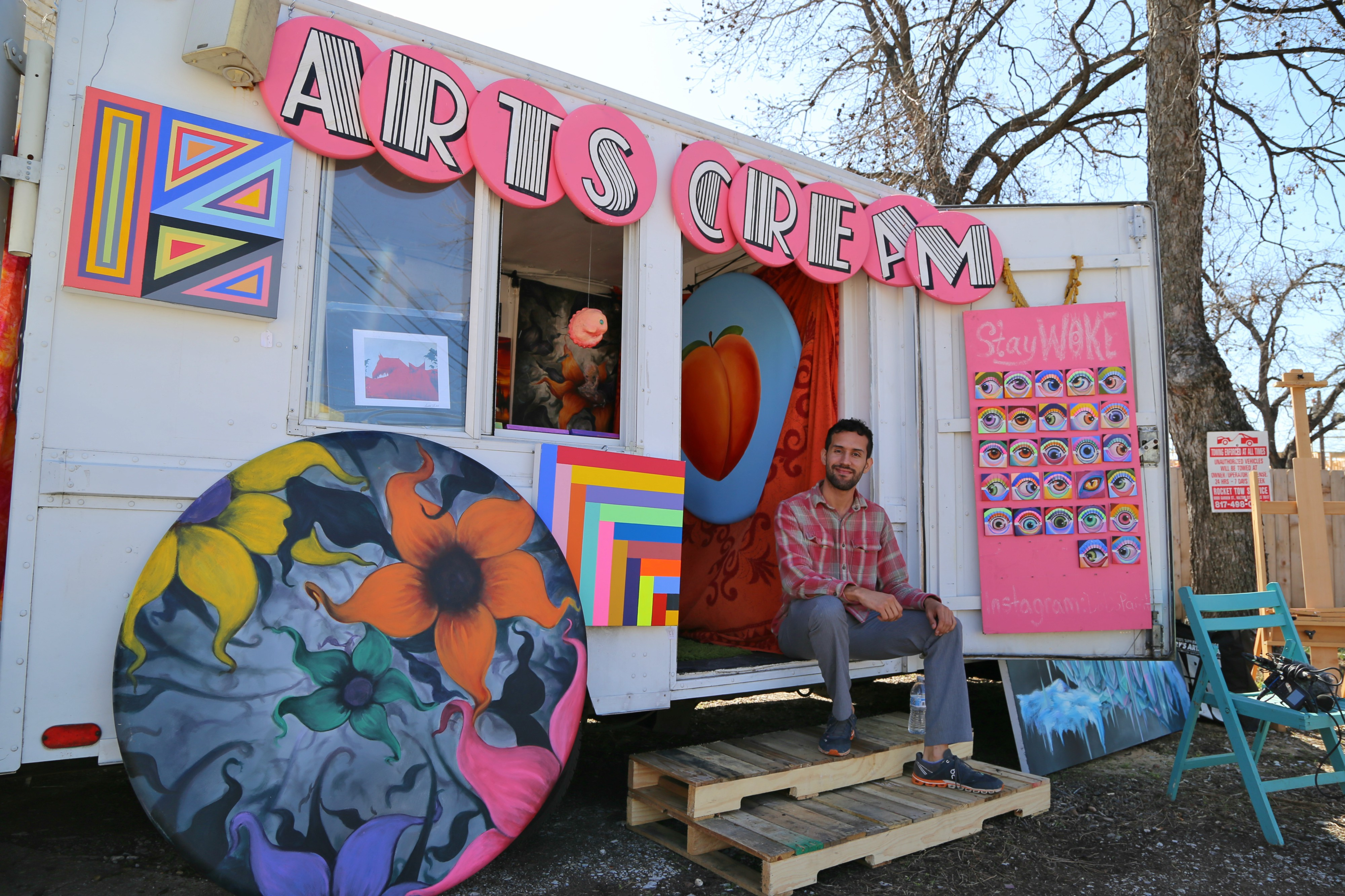 Arnoldo Hurtado sitting in front of his ArtsCream Truck. Photo: Hady Mawajdeh
