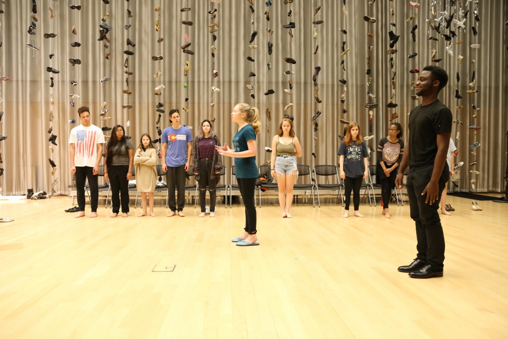 The entire cast rehearses a scene with choreography. Photo: Hady Mawajdeh
