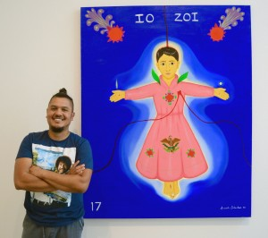 "Armando Sebastian with his self-portrait, ""Mexican Pink,"" featured in the art show ""MaricónX"" at the Latino Cultural Center in July. Photo: Olivia Peregrino"