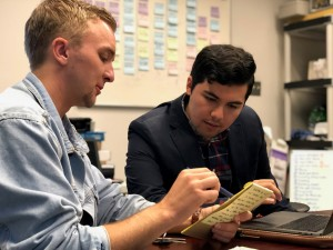 Cine-Más director Gabriel Gutiérrez (right) works with intern on festival preparations. Photo: Hady Mawajdeh