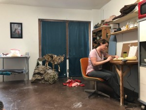 Morgan Grasham sits in her studio working on animal sculptures for a solo exhibition at UNT. Photo: Hady Mawajdeh
