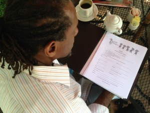 Jones looks over the contract agreement he asks all students to sign before receiving a trumpet. Photo: Willow Blythe