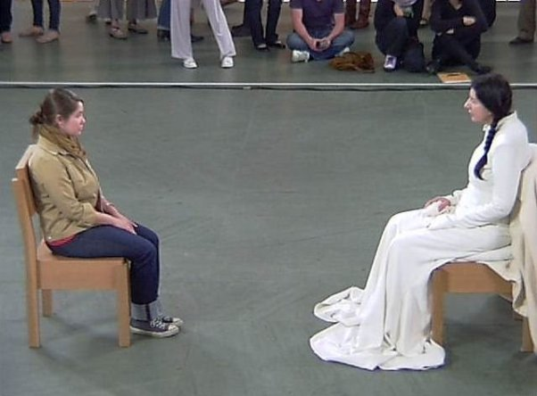 """Dallas artist COURTNEY BROWN eye gazing with Performance Artist MARINA OBROMOVIC at the 2010 """"The Artist is Present"""" exhibit at MOMA. The photo credit is: MICHAEL MAZUREK."""