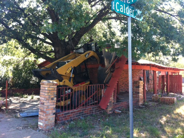 Monday morning, a bulldozer began tearing down the area around the house. Photo: Stephen Becker