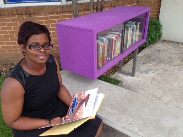 Jamonica Washington checks out a children's book at the Lakewest YMCA's Little Free Library.  Photo: Courtney Collins
