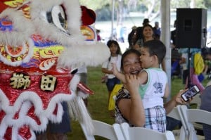 During its performance at Turn Up!, the Chin Woo Lion & Dragon Dance Team interact and play with the crowd. Photo by Christina Ulsh.