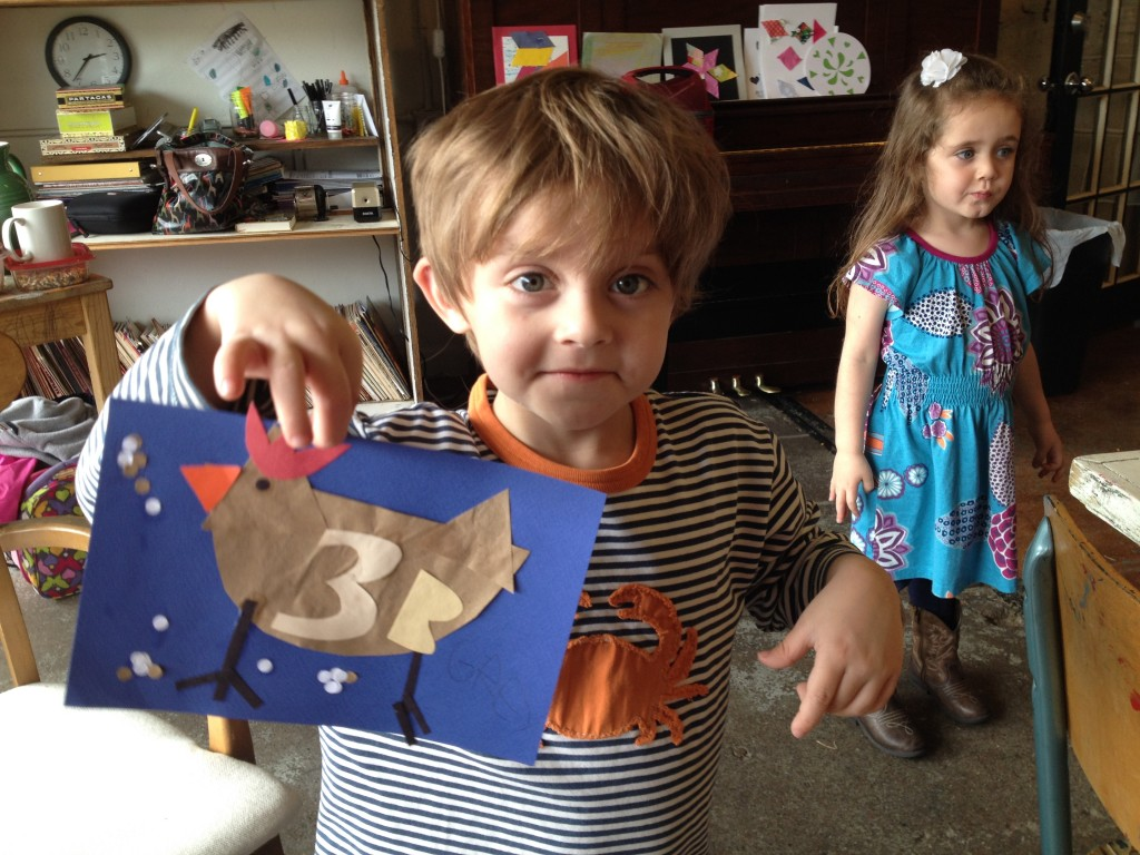 5 year-old Grey Mecca shows off his chicken collage. (photo: Therese Powell)