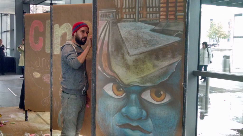 A local artist demonstrates his talent with chalk at Festival Headquarters inside the Winspear Opera House.