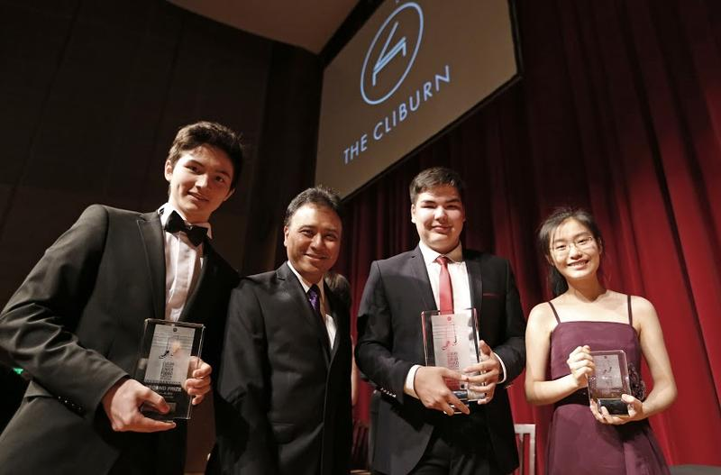 Cliburn Junior award winners Arsenii Mun, 16, of Russia, (second place), Alim Beisembayev, 17, of Kazakhstan, (first prize) and Youlan Ji, 16, of China, (third prize) pose with jury chairman Jon Nakamatsu after the first Cliburn International Junior Piano Competition and Festival, in Fort Worth, Texas, Sunday, June 28, 2015. (The Cliburn/Rodger Mallison)