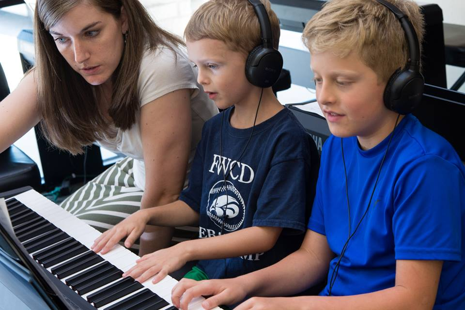The kids will finally learn to play something other than chopsticks if they take a piano camp. Photo: Parker Piano Studios