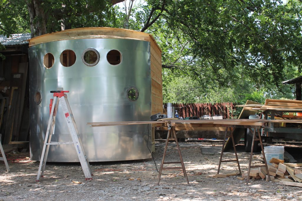 Amy and Reed Butscher build their playhouses out in Wylie, shaded from the summer sun by trees.