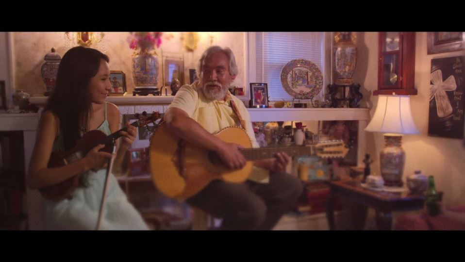 Manuel Casillas and his granddaughter perform a song for his wife.