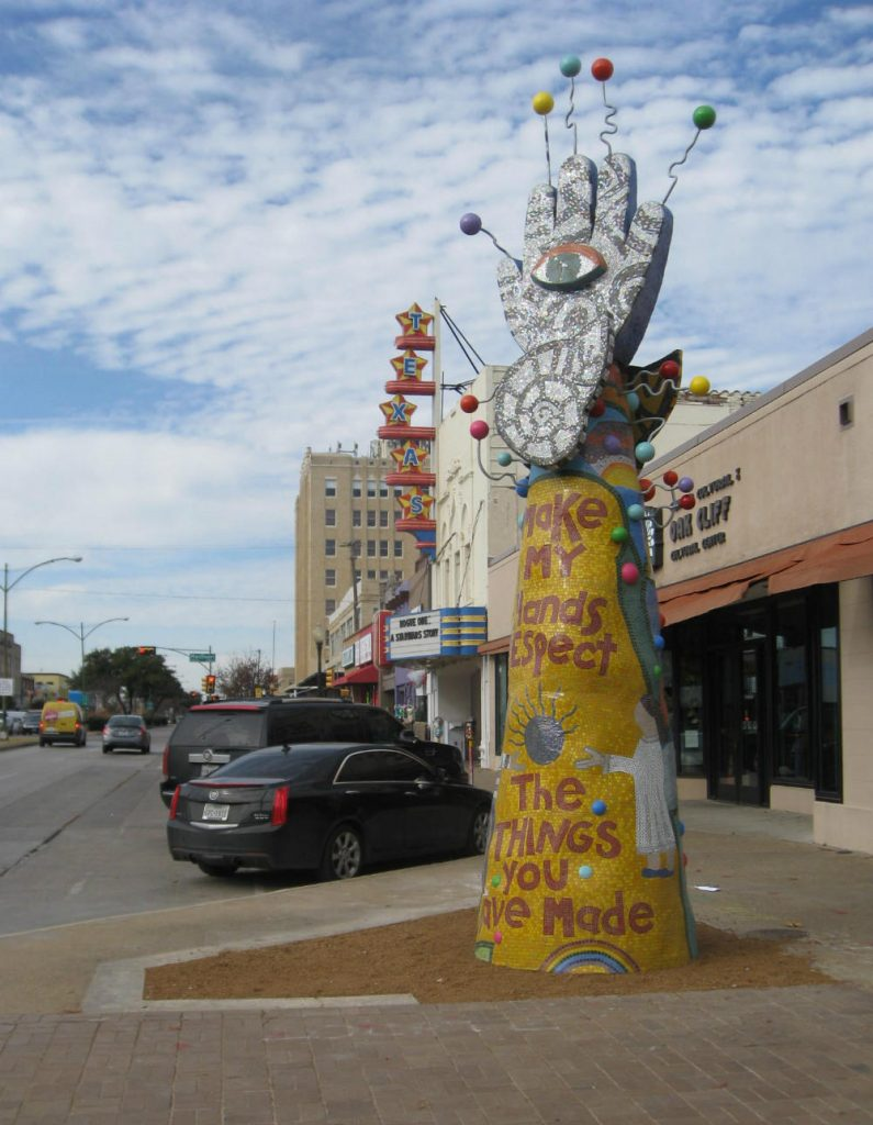 This tall mosaic totem is the first public sculpture from the organization '29 pieces.' If all goes as planned, look for 28 more public sculptures through the years. Photo: BILL ZEEEBLE / KERA NEWS