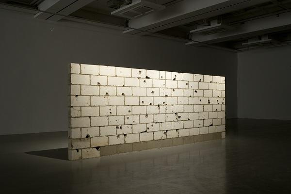 Teresa Margolles -Muro Baleado/Shot Wall (Culiacán), 2009 115 concrete blocks with bullet holes 83 7/8 x 156 x 6 inches (213 x 396 x 15.2 cm) Colección Museo Tamayo, INBA/CONACULTA Photograph by Nils Klinger