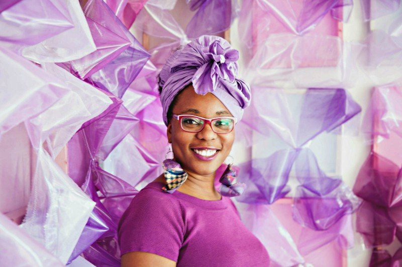 Photo of Chesley Antoinette in front of an installation she crafted. Photo: Sunset Art Studio