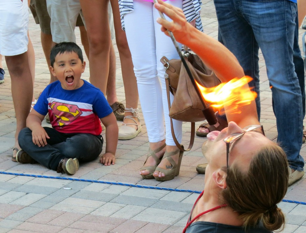Flickr Photo of the Week winner capture child's awe of fire eater.