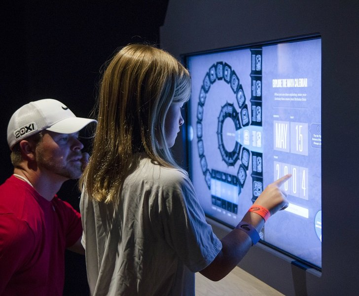 Vistors explore the Maya calendar. Photo: The Perot Museum of Nature and Science