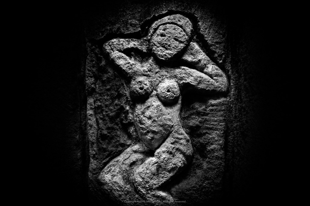 """""""This is a beautiful abstract nude that could be in an art museum,"""" photographer Jeff Gusky says of this figure, carved into the quarry wall by a World War I soldier. Jeffrey Gusky/Courtesy of the National Air and Space Museum"""