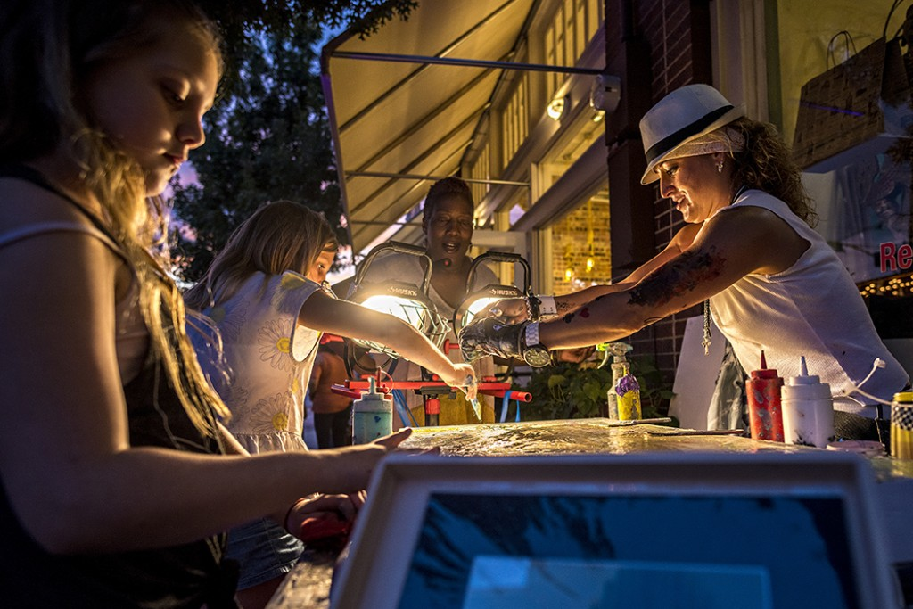 Kids participate in a painting demonstration at the Tyler/Davis block party in October. Photo: Danny Fulgencio/Oak Cliff Advocate