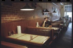 Driensky posing at a diner. Photo: Exploredinary