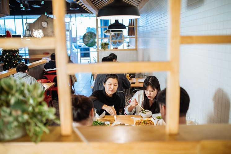 Diners sample dishes at Big Claw, which opened in Plano in April with the goal of serving authentic Chinese dishes to Asian-American millennials. Photo: Kathy Tran
