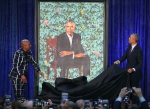 Former President Barack Obama and artist Kehinde Wiley unveil his portrait during a ceremony at the Smithsonian's National Portrait Gallery. Photo: Mark Wilson/Getty Images via NPR