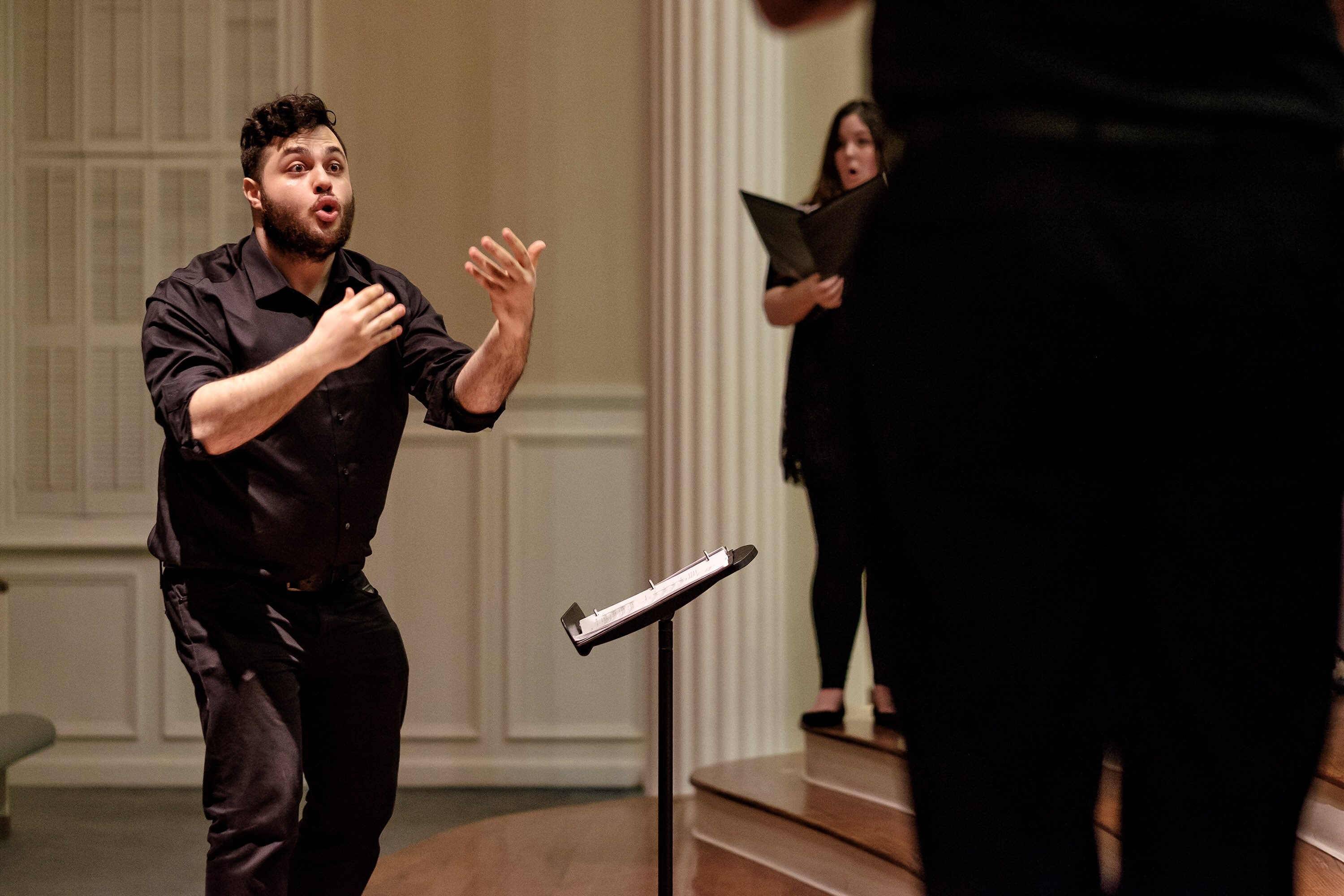 "Sam Brukhman conducting the ensemble during their recent performance of ""The Consolation of Apollo."" Photo: Dickie Hill"